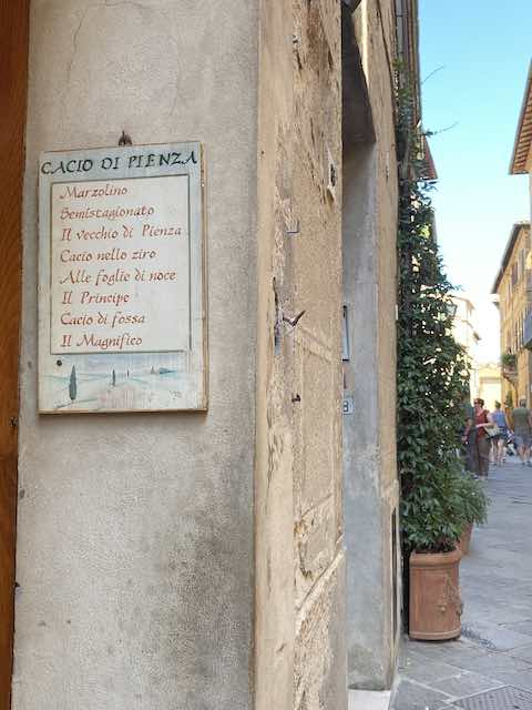 sign outside cheese shop in Pienza selling Pecorino cheese